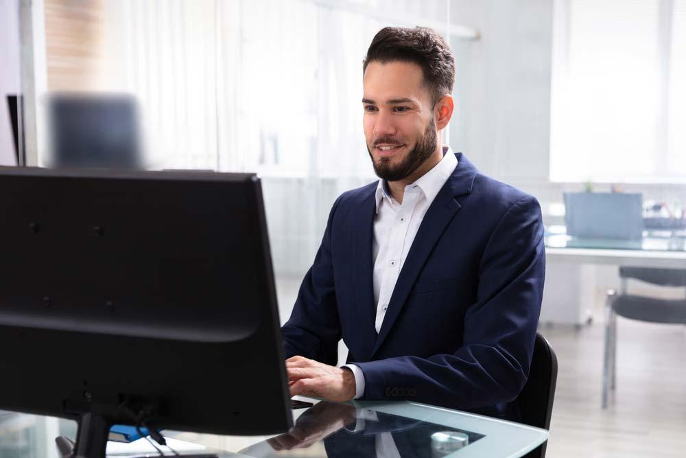 Man creating LinkedIn profile on computer